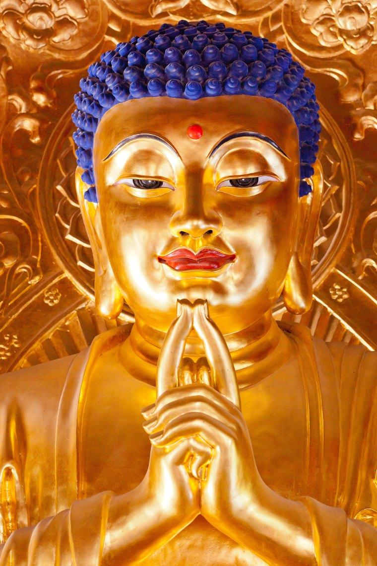 Golden Buddha photo by Detlev Klockow via Unsplash